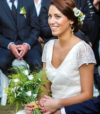Beautiful bride at the altar by Professional Hair Stylist and Makeup Artist